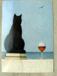 postcard shows a cat by the sea