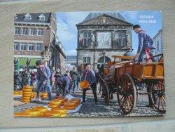 postcard Gouda cheese market in city Gouda Netherlands