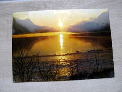 postcard switzerland with lake, mountain and sunset