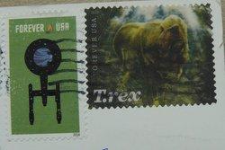trex dinosaur hologram stamp USA