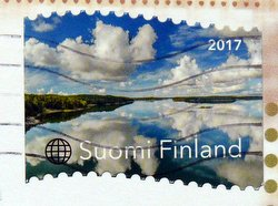 finnish postage stamp lake and sky reflection
