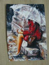 Postcard girl in red coat sitting in rain with umbrella